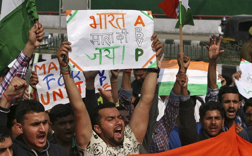 Activists from ABVP raise their hands as they shout slogans during a protest march in Jammu