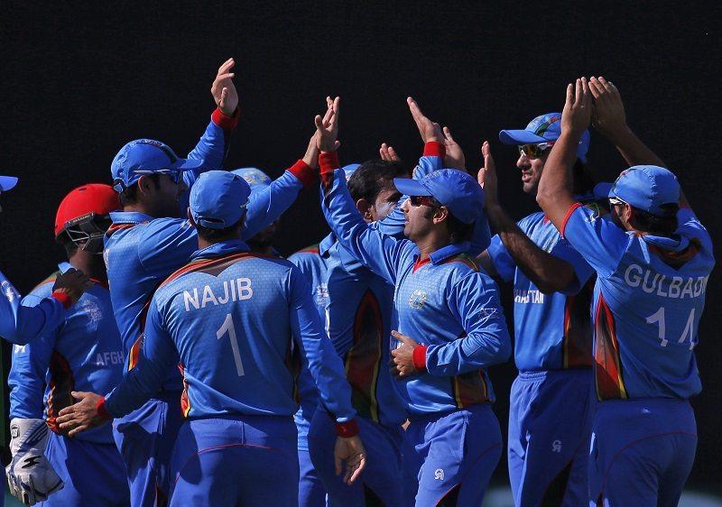 Cricket - England v Afghanistan - World Twenty20 cricket tournament - New Delhi, India, 23/03/2016. Afghanistan's players celebrate the dismissal of England's Jos Buttler. REUTERS/Adnan Abidi - RTSBUD2