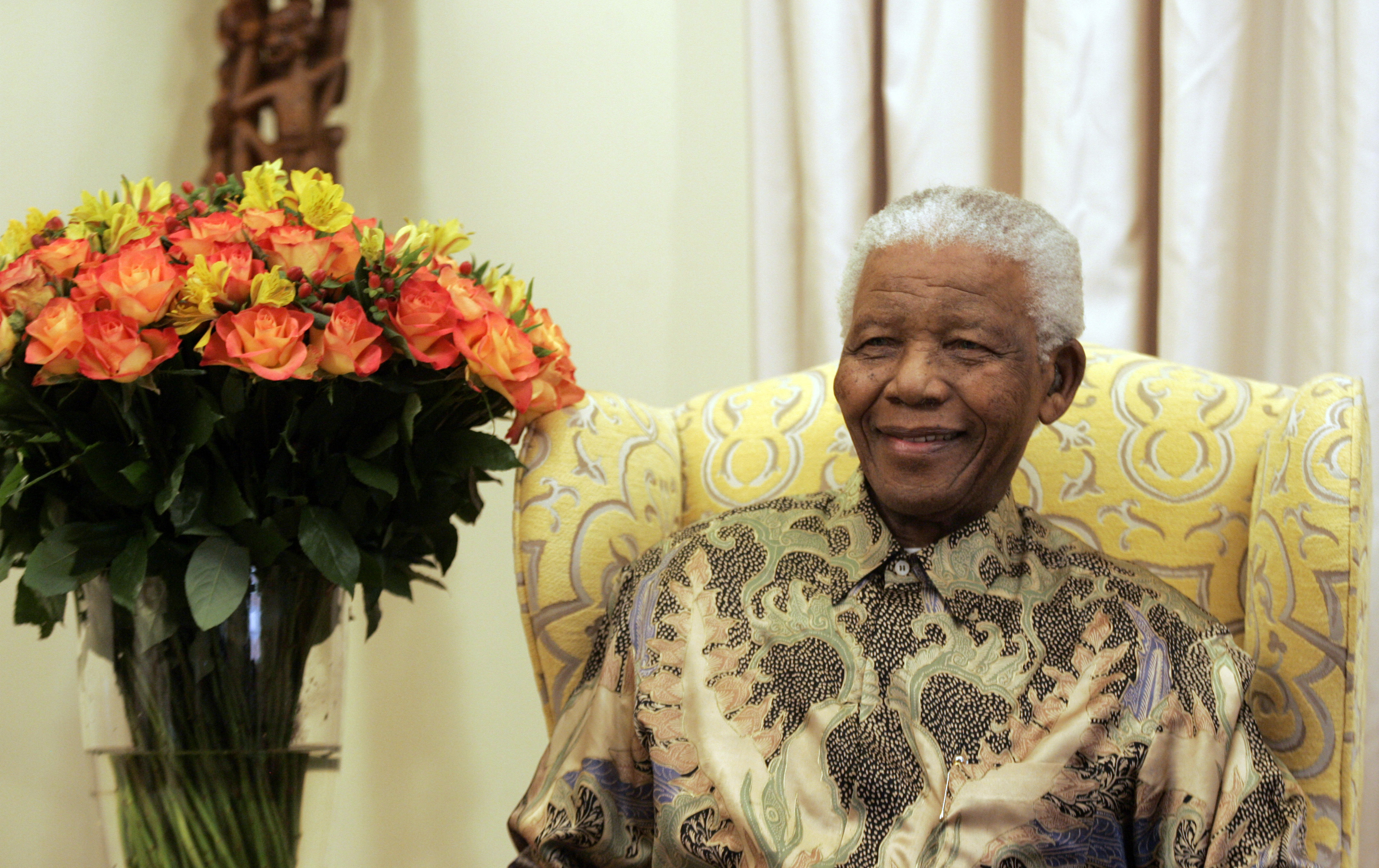 Former South African President Nelson Mandela laughs during an interview with the media at his house in Qunu, Eastern Cape, July 18, 2008. Anti-apartheid icon Mandela celebrated his 90th birthday on Friday. The Nobel peace laureate, who retired from politics nine years ago, has become a symbol of freedom admired the world over. REUTERS/Themba Hadebe/Pool (SOUTH AFRICA) - RTX81T9