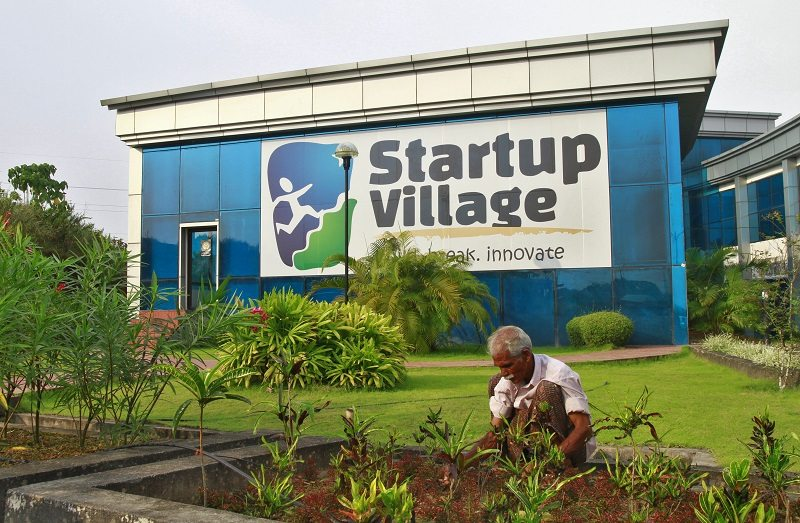 A gardener plants seedlings at the entrance of Start-up Village in Kinfra High Tech Park in the southern Indian city of Kochi October 13, 2012. Three decades after Infosys, India's second-largest software service provider, was founded by middle-class engineers, the country has failed to create an enabling environment for first-generation entrepreneurs. Startup Village wants to break the logjam by helping engineers develop 1,000 Internet and mobile companies in the next 10 years. It provides its members with office space, guidance and a chance to hobnob with the stars of the tech industry. But critics say this may not even be the beginning of a game-changer unless India deals with a host of other impediments - from red tape to a lack of innovation and a dearth of investors - that are blocking entrepreneurship in Asia's third-largest economy. To match Feature INDIA-TECHVILLAGE/ Picture taken October 13, 2012. REUTERS/Sivaram V (INDIA - Tags: BUSINESS EMPLOYMENT SCIENCE TECHNOLOGY) - RTR3B6DT
