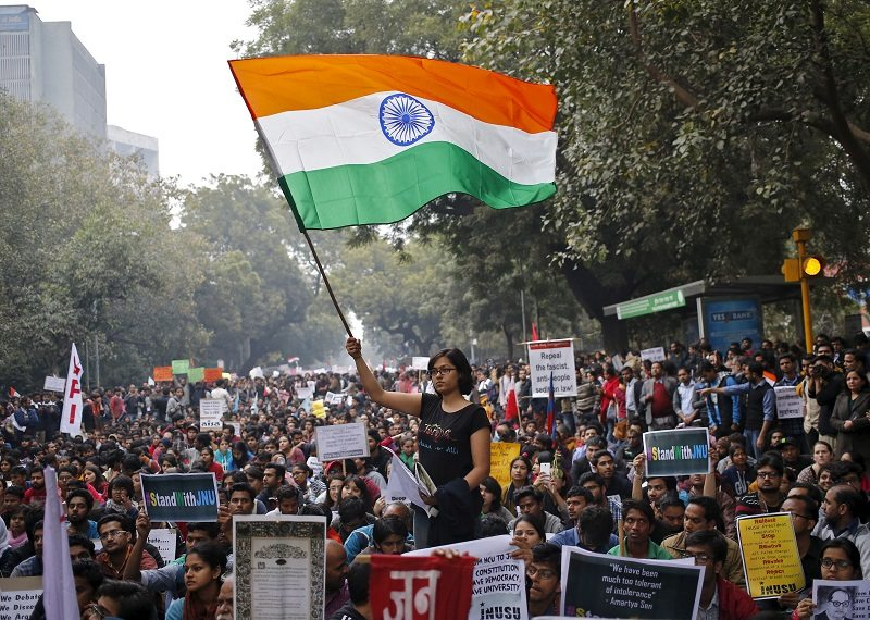 A demonstrator waves Indian national flag as she takes part in a protest demanding the release of Kanhaiya Kumar, a Jawaharlal Nehru University (JNU) student union leader accused of sedition, in New Delhi, India, February 18, 2016. REUTERS/Anindito Mukherjee - RTX27J90
