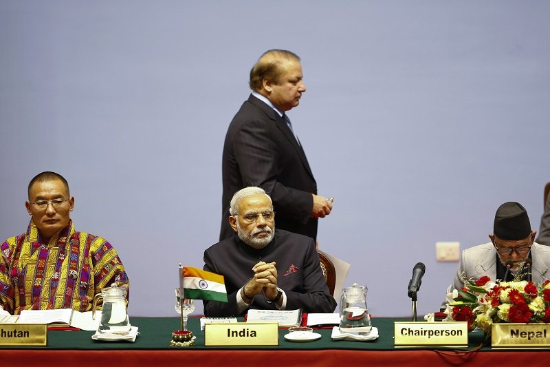 Bhutan's Prime Minister Tshering Tobgay (L), India's Prime Minister Narendra Modi (C), Pakistan's Prime Minister Nawaz Sharif (C, standing) and Nepal's Prime Minister Sushil Koirala attend the opening session of 18th South Asian Association for Regional Cooperation (SAARC) summit in Kathmandu November 26, 2014. South Asian leaders from Afghanistan to the Maldives met in Kathmandu on Wednesday for a summit that was undermined by traditional bickering between rivals Pakistan and India. REUTERS/Narendra Shrestha/Pool (NEPAL - Tags: POLITICS) - RTR4FO2S
