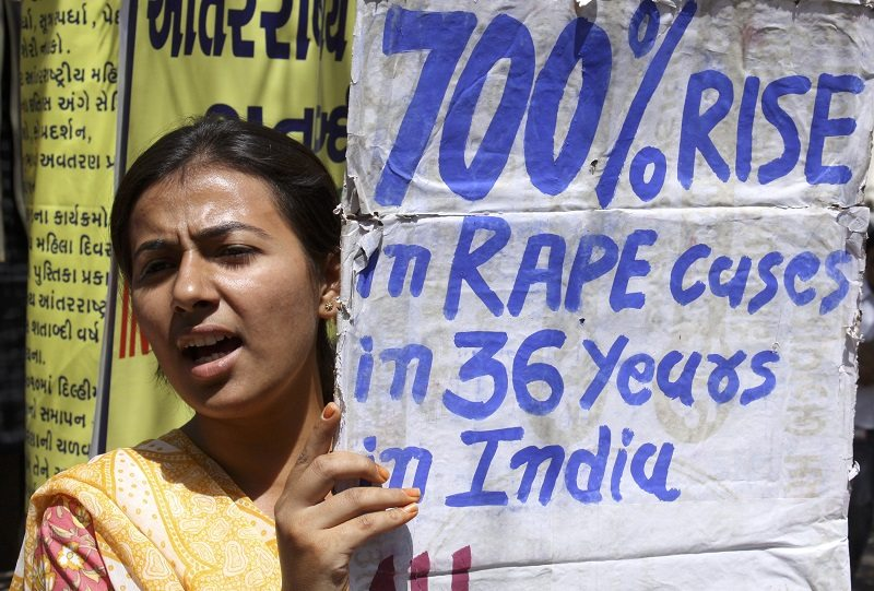 A member of All India Mahila Sanskritik Sanghatan (AIMSS) holds a placard during a demonstration against what they say is violence against women ahead of the International Women's Day, in the western Indian city of Ahmedabad March 6, 2009. The International Women's Day will be celebrated on March 8. REUTERS/Amit Dave (INDIA) - RTXCF65