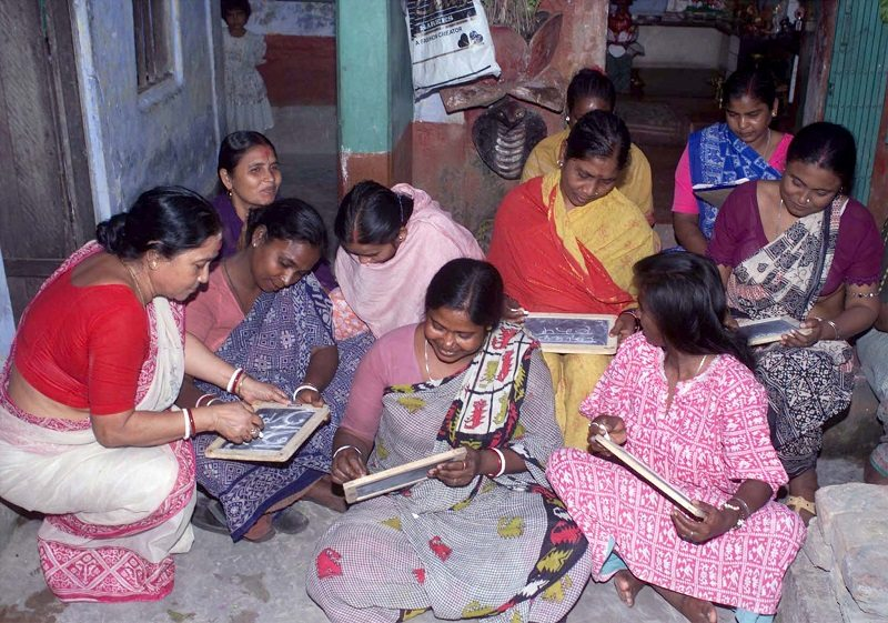 Bela Roy (L), teaches the local Bengali alphabet to prostitutes in the eastern Indian city of Calcutta March 7. Voluntary organisations say most prostitutes are from socially and economically backward sections of society. Many prostitutes in Calcutta are participating in rallies on the occasion of the International Women Day on Wednesday. JS/TAN - RTR20PC