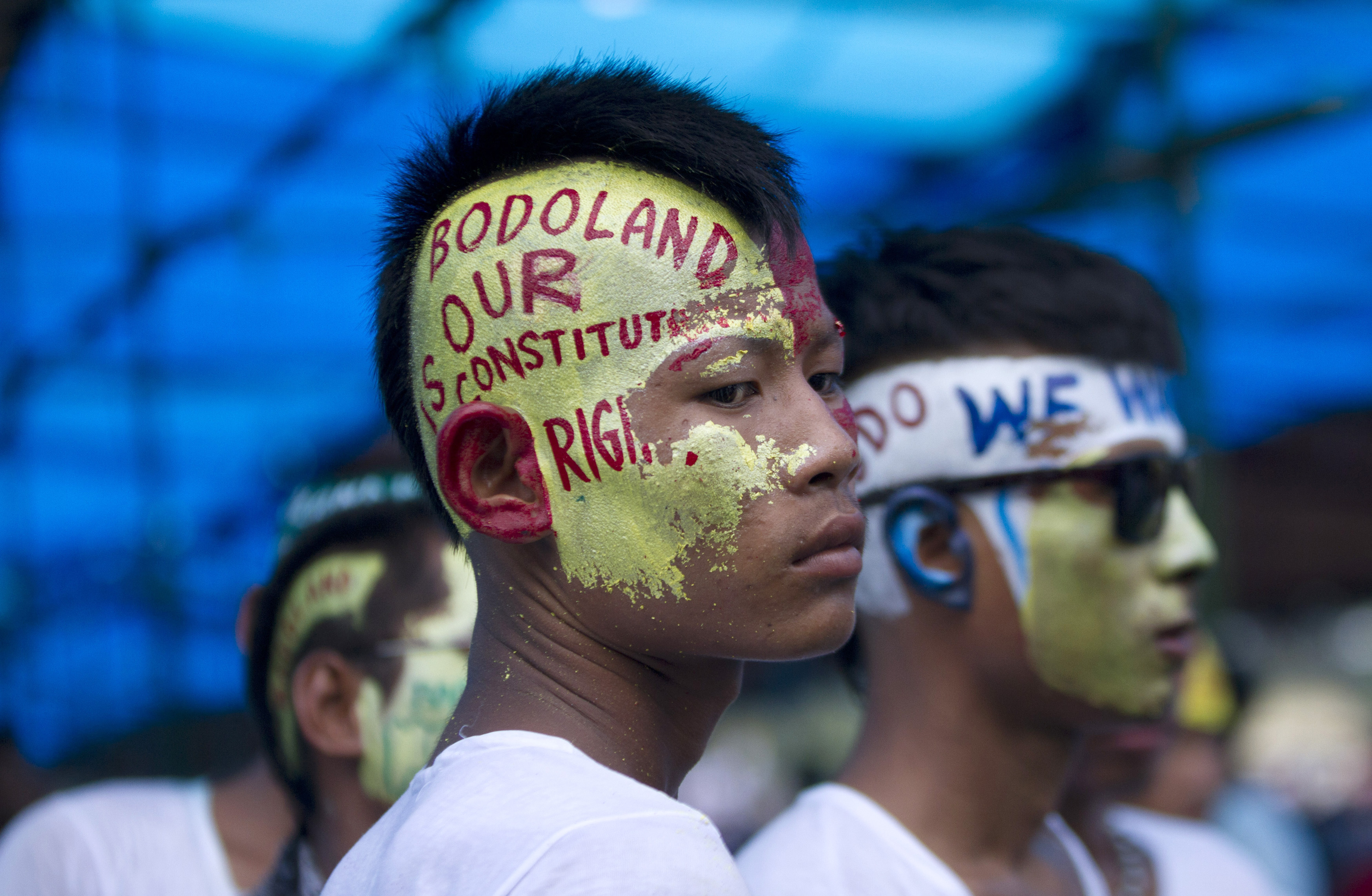 Supporters of Bodoland People's Front (BPF), a local political party, with their faces painted attend a rally at Kokrajhar in the northeastern Indian state of Assam August 4, 2013. Thousands of the supporters on Sunday held a rally to protest against the Indian government in their demand for a separate Bodoland state carved out of Assam, BPF supporters said. REUTERS/Stringer (INDIA - Tags: POLITICS CIVIL UNREST) - RTX12A30