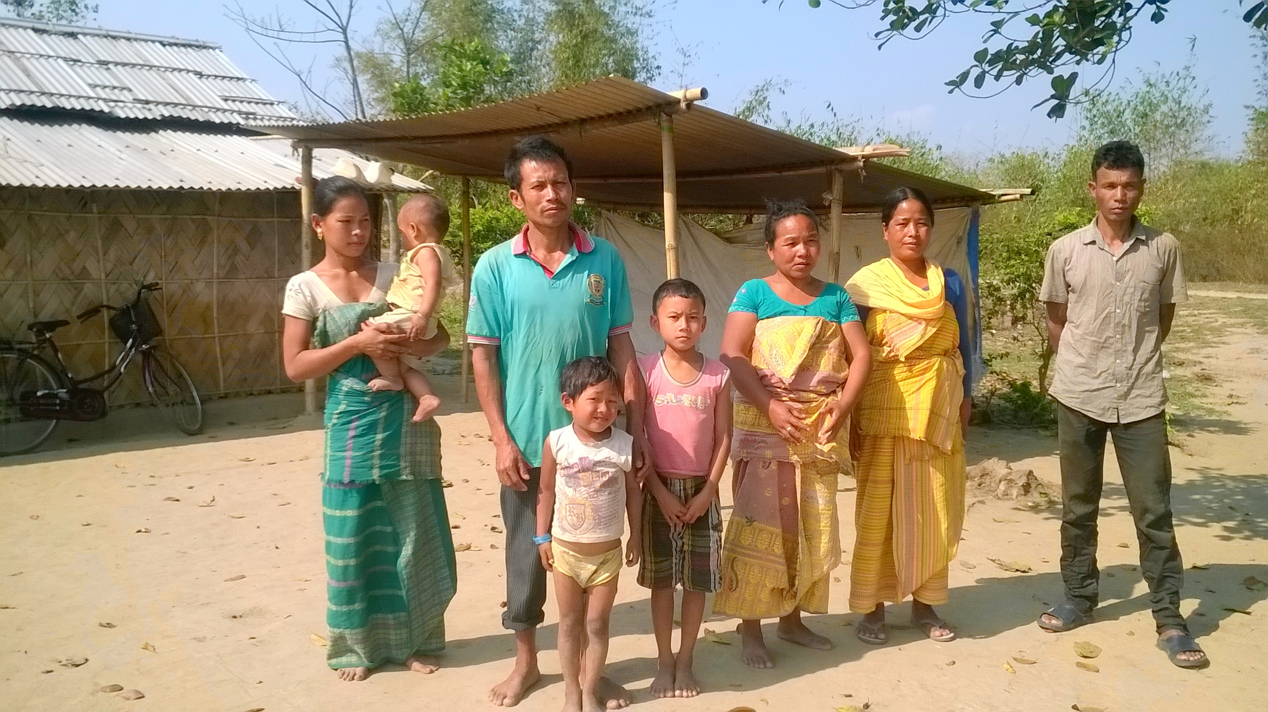 A Bodo family in one of the villages burnt down during the 2014 conflict.