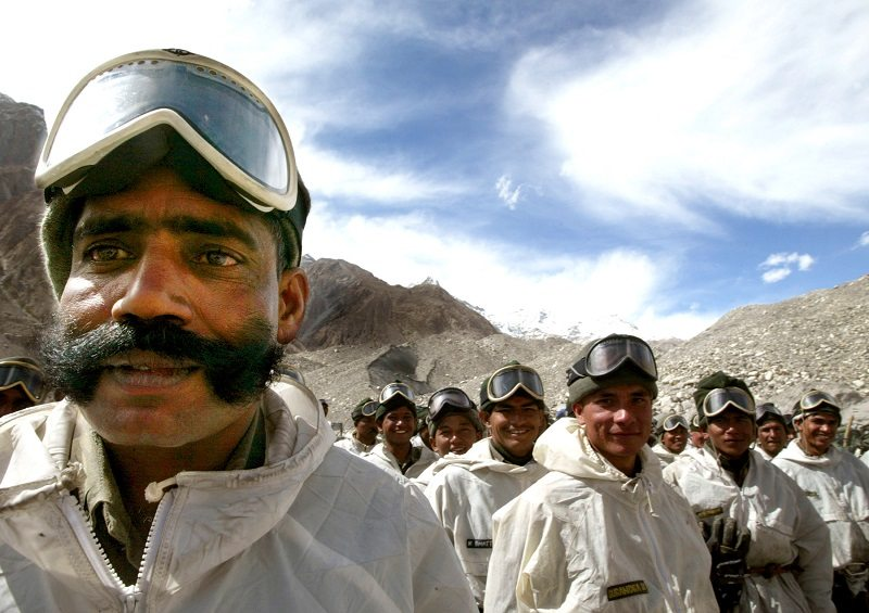 Indian army soldiers muster at their base camp after returning from training at Siachen Glacier, October 4, 2003. For 18 years, Pakistani and Indian soldiers have clung to Siachen, which lies north of the end of the Line of Control dividing disputed Kashmir, and just below the border with China. Siachen is 78 km (48 miles) long and lies at an altitude of 5,400 metres, the world's highest battlefield with temperatures as low as - 60degC (-76 Farenheit). Picture taken October 4, 2003. PP03110021 REUTERS/Pawel Kopczynski AH/TW - RTR4ASH