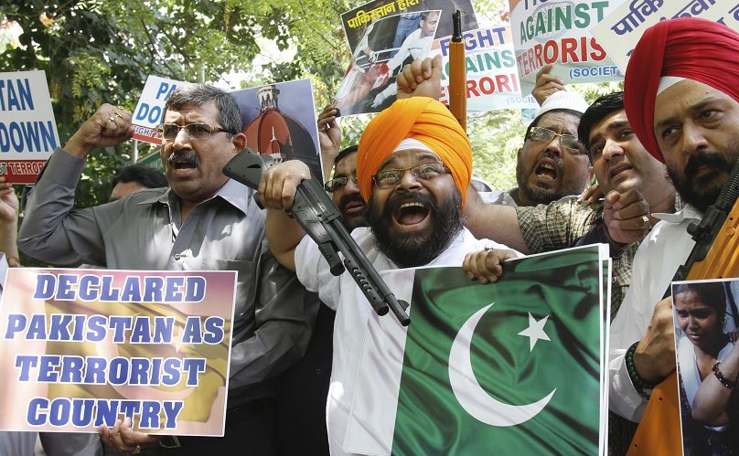 Members of Fight against Terrorism Society and National Akali Dal, a regional Sikh political party, hold toy guns, placards and a cutout of Pakistan's national flag during a protest in New Delhi May 8, 2011. Dozens of members on Sunday protested against what they say is Pakistan's support of terrorism and urged the U.S. to declare Pakistan as a terrorist nation, according to a media release by the two organizations. REUTERS/B Mathur (INDIA - Tags: CIVIL UNREST POLITICS) - RTR2M4UN