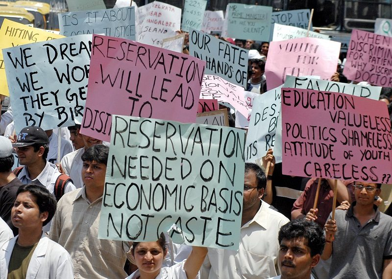 Medical students carry placards as they participate in a protest rally in the southern Indian city of Bangalore May 14, 2006. Emergency services were hit in some New Delhi hospitals on Sunday as junior doctors and medical students went on a strike to protest against a government move to reserve more college places for the underprivileged in India. REUTERS/Jagadeesh nv - RTR1DD82