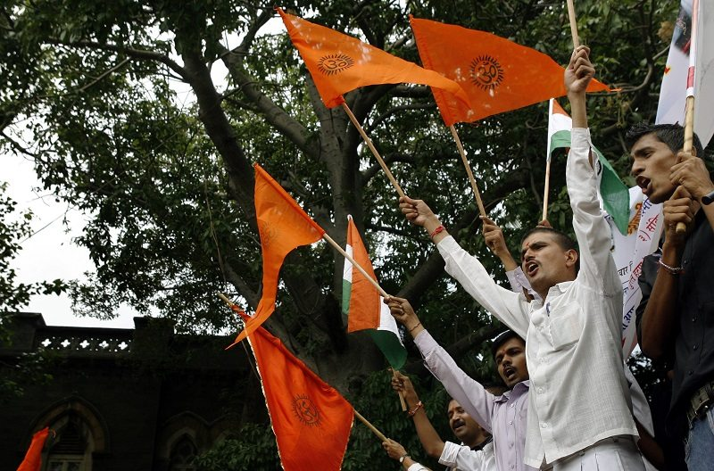 Activists of Vishwa Hindu Parishad, a hardline Hindu group, shout during a protest over a land row in Mumbai August 21, 2008. The row has posed a political dilemma for India's Prime Minister Manmohan Singh months before a general election due by May. The government must find a solution that does not alienate either Muslims or Hindus, both important voter constituencies. REUTERS/Punit Paranjpe (INDIA) - RTR21I3G