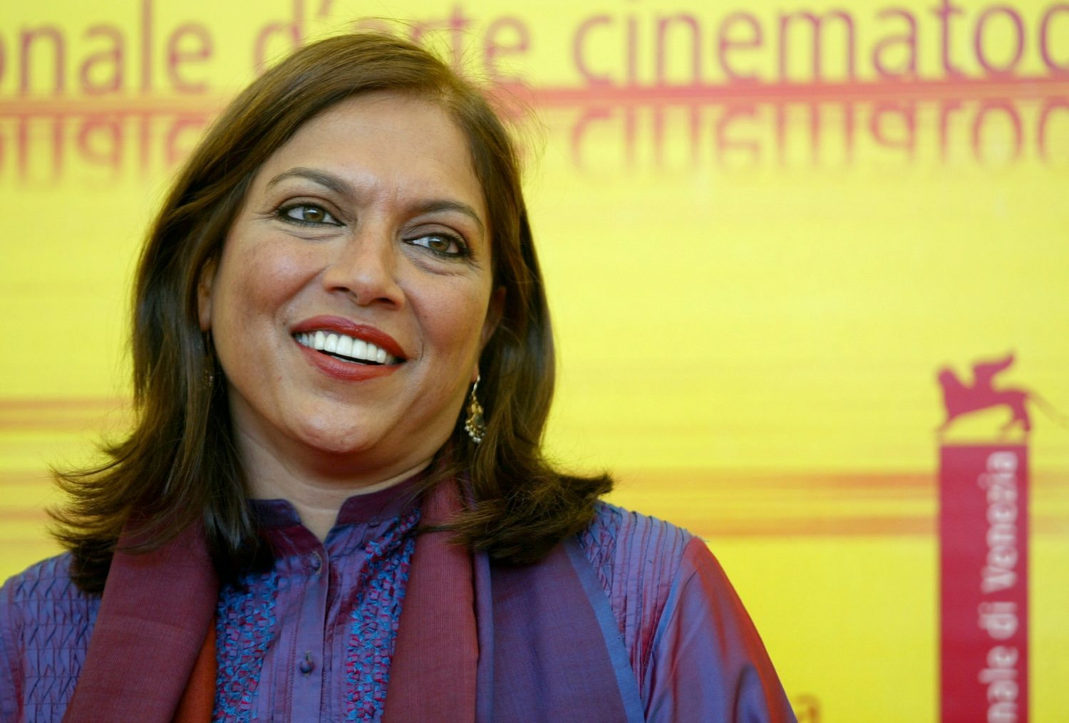 Indian director Mira Nair poses during a photo call at the Venice Lido September 5, 2004. Nair's movie 'Vanity Fair' is in competition at the Venice film festival. - RTXMX6R