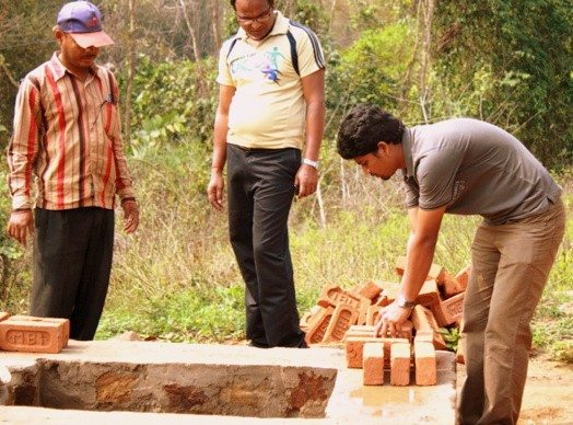 Building toilets as part of the water & sanitation project with Gram Vikas