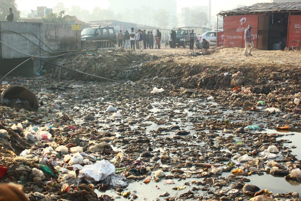 Literally stacked on dumpyards, the workers and their families are exposed to terrible living conditions.