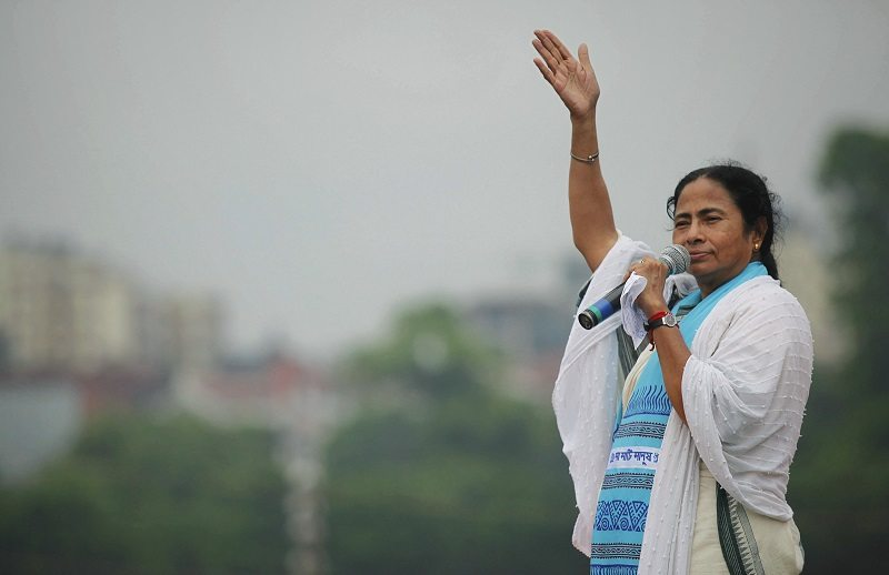 The newly appointed chief minister of eastern Indian state of West Bengal and Trinamool Congress (TMC) Mamata Banerjee addresses her supporters during a rally in Kolkata July 21, 2011. The annual rally was held to commemorate the July 21, 1993 event where 13 political party workers were killed by the police, and also to celebrate their historic win in the recent concluded state elections, TMC leaders said on Thursday. REUTERS/Rupak De Chowdhuri (INDIA - Tags: POLITICS CIVIL UNREST) - RTR2P4H0