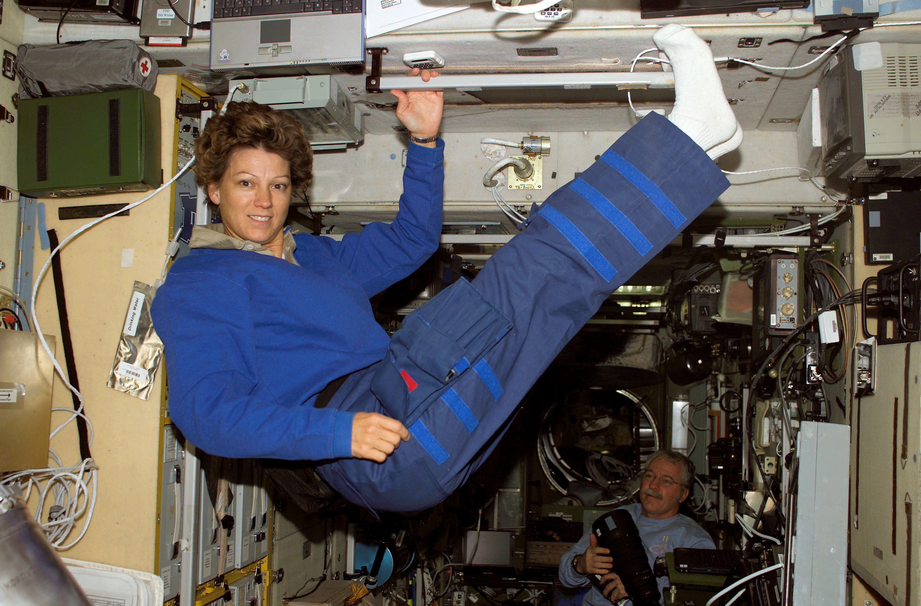 - PHOTO TAKEN 05AUG05 - Astronaut Eileen Collins, STS-114 commander, floats in the Zvezda Service Module of the International Space Station while Space Shuttle Discovery was docked to the Station, August 5, 2005. Astronaut John Phillips, Expedition 11 NASA Space Station science officer and flight engineer, is visible at bottom right. Picture taken August 5, 2005.  ? EDITORIAL USE ONLY - RTXNORM