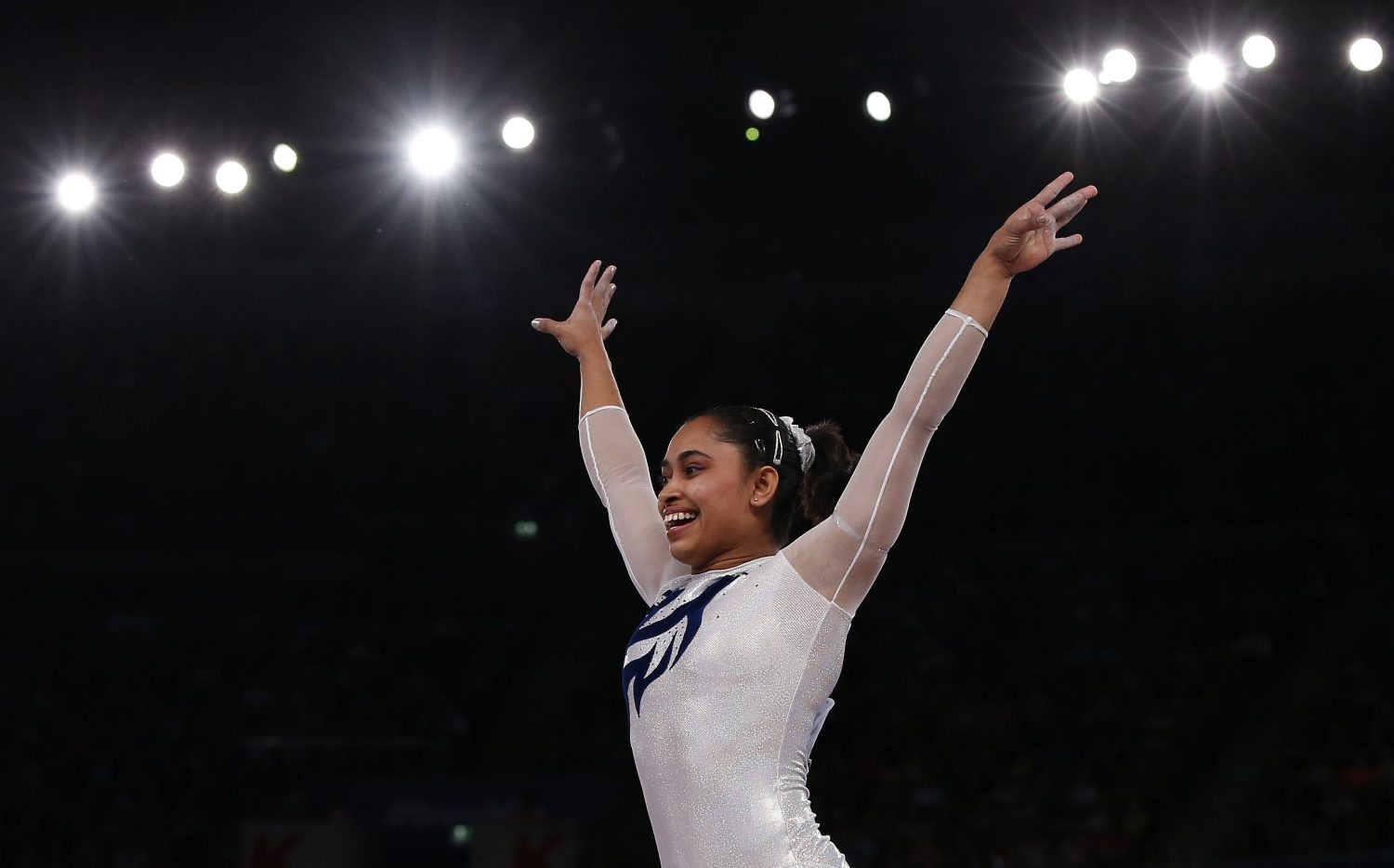 India's Dipa Karmakar reacts after a successful vault during the women's gymnastics vault apparatus final at the 2014 Commonwealth Games in Glasgow, Scotland, July 31, 2014. REUTERS/Phil Noble (BRITAIN - Tags: SPORT GYMNASTICS) - RTR40TZT