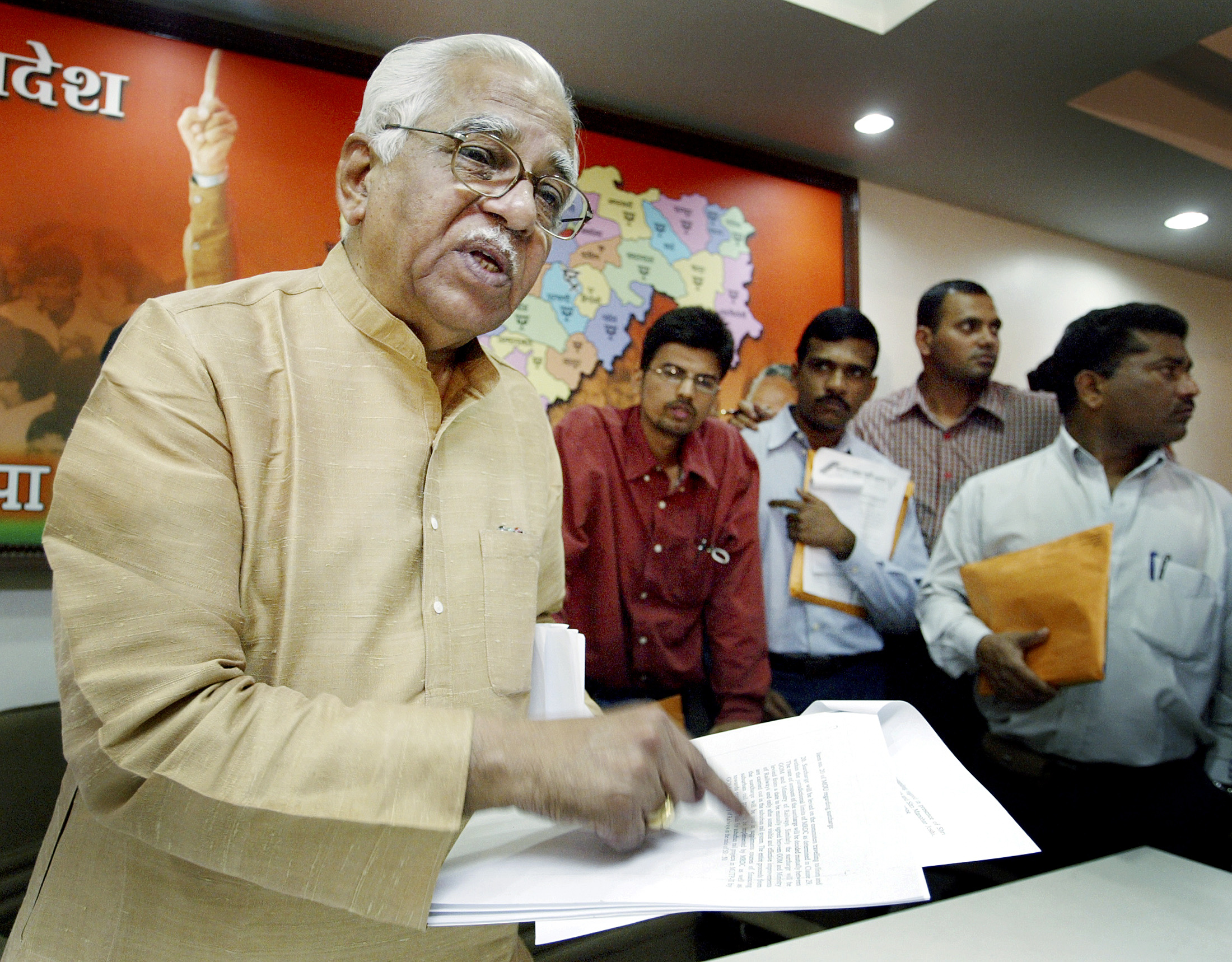 India's Petroleum Minister Ram Naik speaks during a media gathering in Bombay September 16, 2003. Naik said on Tuesday that state-run Indian Oil Corporation, Oil and Natural Gas Corporation and Gas Authority of India Limited will not be privatised. The minister addressed the news conference hours after a ruling by the Supreme Court asking the government to seek parliamentary approval for selling stakes in two state-run oil refineries, which he said was a historic decision. REUTERS/Sherwin Crasto SC/TW - RTR33GN