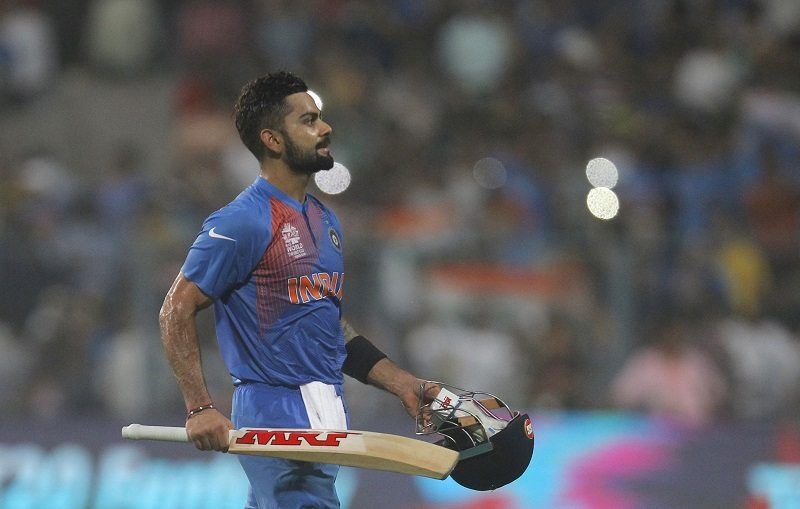 Cricket - India v Pakistan- World Twenty20 cricket tournament - Kolkata, India, 19/03/2016. India's Virat Kohli walks off the field after winning their match against Pakistan. REUTERS/Rupak De Chowdhuri - RTSB8F8