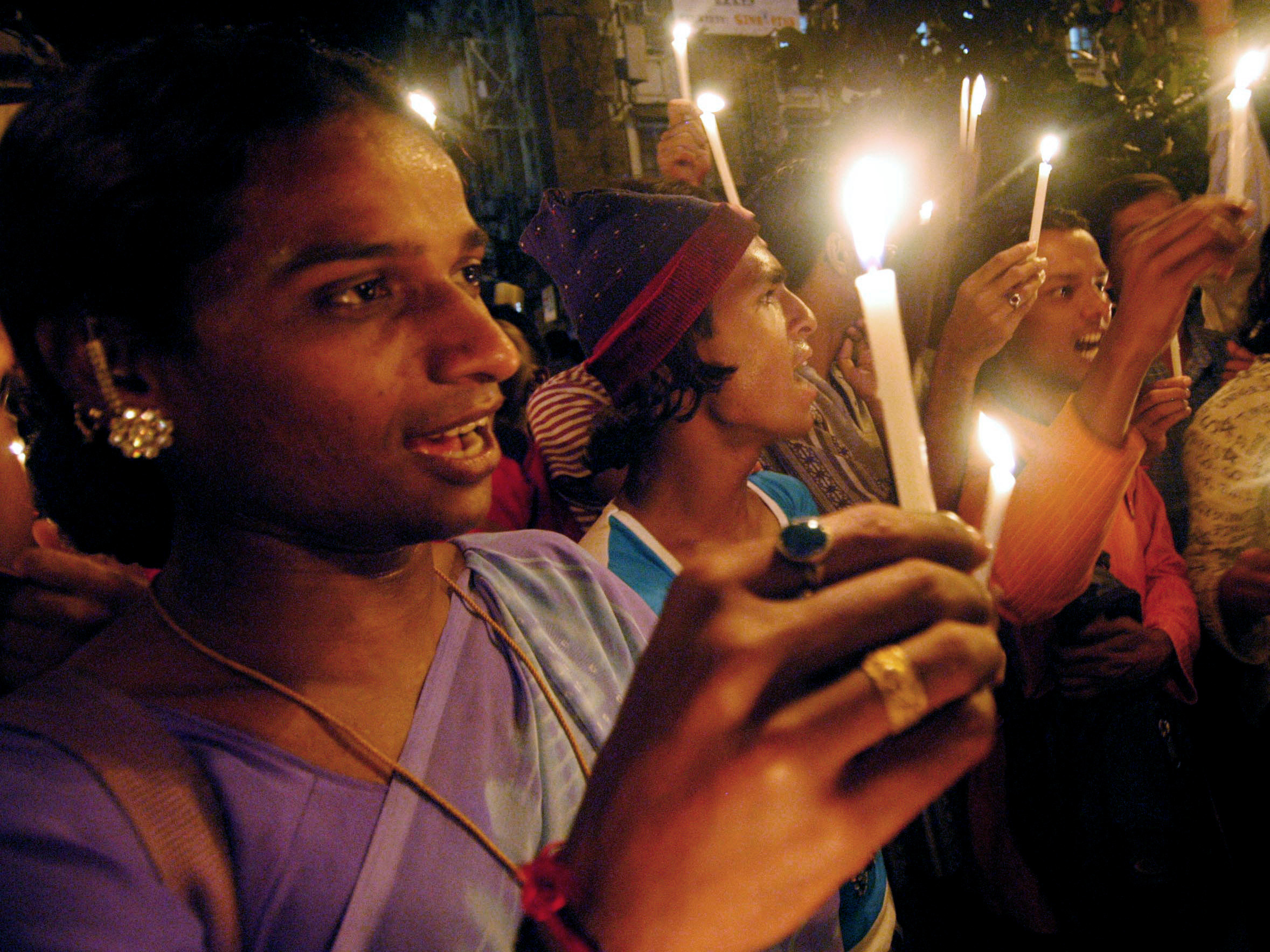 "Indian gays and transgenders hold candles during a demonstration to protest against a particular section of the Indian law in Mumbai August 16, 2005. The demonstrators claimed that the section of the Indian law which deals with ""unnatural offences"", discriminates against gays, lesbians, bisexuals and transgenders. REUTERS/Stringer  AD/JJ - RTRKQGM"