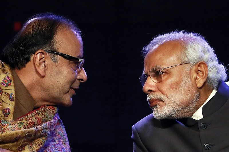 Indian Prime Minister Narendra Modi (R) listens to Finance Minister Arun Jaitley during the Global Business Summit in New Delhi January 16, 2015. Modi said on Friday that he was committed to meeting this year's budget deficit target, and he welcomed a cut in interest rates by the Reserve Bank of India on the back of falling inflation. REUTERS/Anindito Mukherjee (INDIA - Tags: BUSINESS POLITICS TPX IMAGES OF THE DAY) - RTR4LQA3