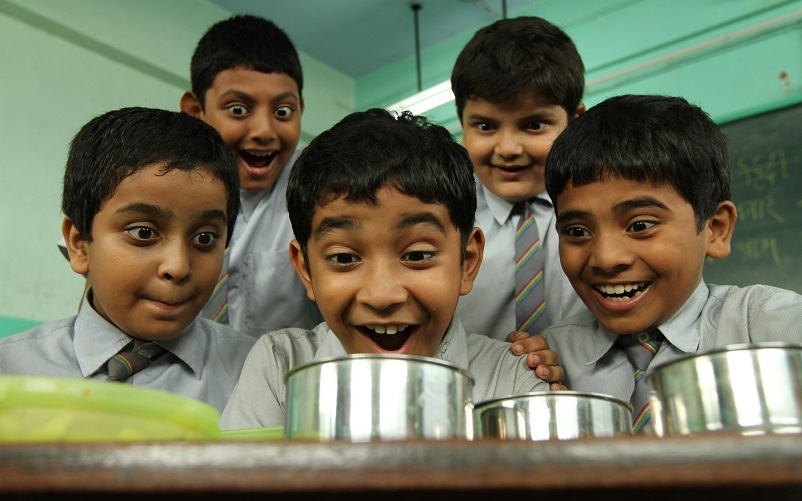 Still from Stanley Ka Dabba, a bunch of school boys stare at their lunch in amazement