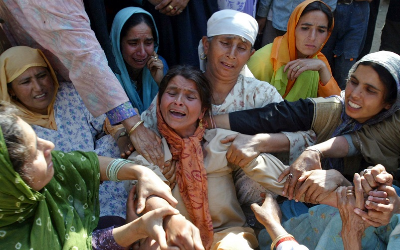 A mother of a Kashmiri boy and girl, both of whom died when a boat capsized, is consoled by other women during a funeral in Handwara, 80 km (50 miles) north of Srinagar, May 31, 2006. At least 20 school children died in Indian Kashmir on Tuesday after their boat capsized in the region's largest lake, police and army officials said. The children were on a trip when their boat went down the Wular Lake, about 65 km (40 miles) north of Srinagar, Kashmir's summer capital. REUTERS/Fayaz Kabli - RTR1DXW4