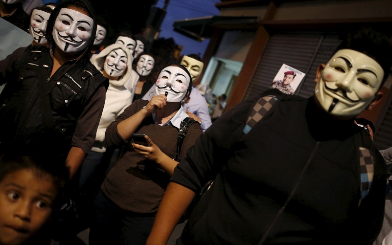 "Protesters from the online activist group ""Anonymous"" wearing Guy Fawkes masks march in downtown Guatemala, November 5, 2015. The group claims to be mobilizing protests in more than 600 cities worldwide as part of what they call the ""Million Mask March"" held on Guy Fawkes day. REUTERS/Jorge Dan Lopez - RTX1UZ08"