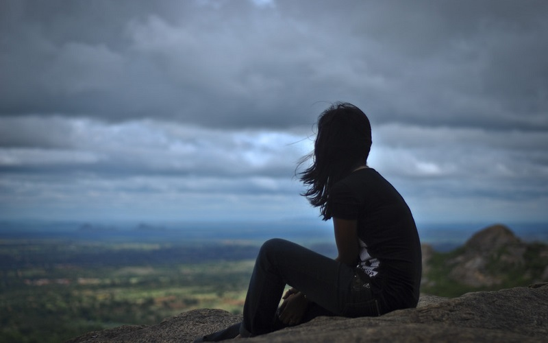 lonely girl on a hill