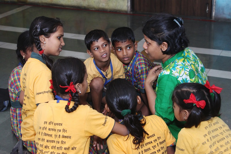 Engrossed students and facilitator in an Apni Shala session