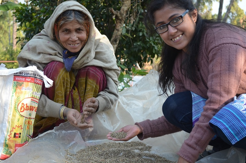 Amrita Bhattacharya checking out seeds for farming with a local woman.