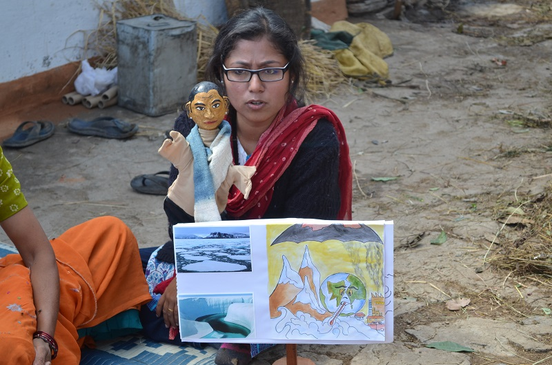 Amrita uses the puppet Samajhdar Chacha to explain climate change to rural women in Kumaon.