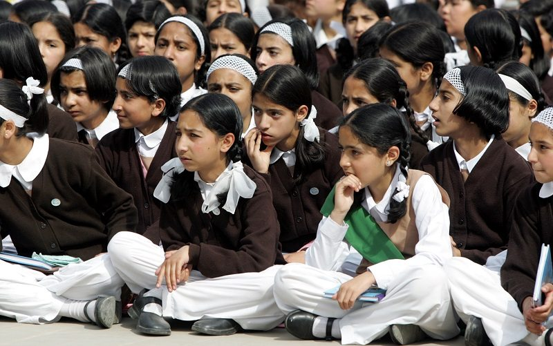Kashmiri girls from missionary school listen during prayer meeting for recovery of injured schoolmates in Srinagar. Kashmiri girls from a missionary school listen during a prayer meeting for the recovery their schoolmates injured in a grenade explosion in Srinagar May 16, 2005. Suspected rebels detonated a grenade near a missionary school in the heart of Srinagar last Thursday, killing two women and wounding about 50 people, including twenty children. REUTERS/Fayaz Kabli - RTRB9AU