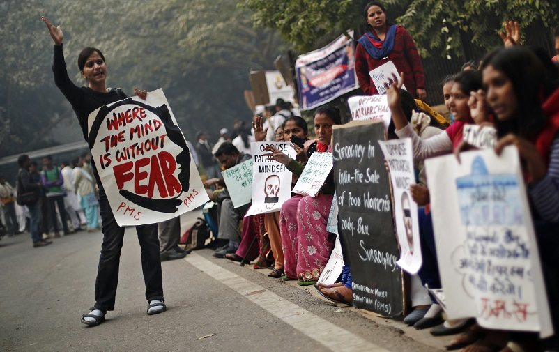 Protesters carry placards as they shout slogans during a protest to mark the first anniversary of the Delhi gang rape, in New Delhi December 16, 2013. A 23-year-old woman was gang-raped on a moving bus in Delhi on December 16, 2012, beaten and then pushed out onto the street along with her male companion. She died two weeks later amid an outpouring of anger across India. Four men were sentenced to death while a teenager was sentenced to juvenile custody. REUTERS/Adnan Abidi (INDIA - Tags: CRIME LAW CIVIL UNREST ANNIVERSARY) - RTX16KU9