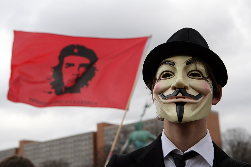 BERLIN, GERMANY - FEBRUARY 25: An activist in a Guy Fawkes mask protests during a demonstration against the Anti-Counterfeiting Trade Agreement (ACTA) on February 25, 2012 in Berlin, Germany. ACTA is a proposed treaty attempting to establish an international governing body with legal standards intended to protect intellectual property and prevent the production and sale of counterfeit goods. The German government has delayed a decision on the agreement, citing concerns by the Justice Ministry, and according to news reports is waiting for approval by the European Parliament prior to signing the multinational treaty. (Photo by Adam Berry/Getty Images)