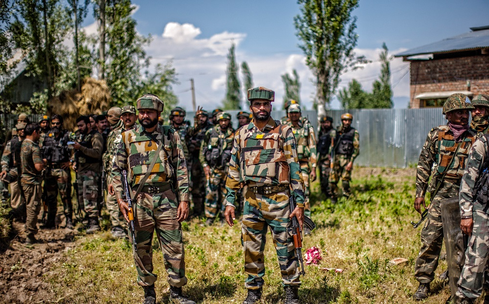 Indian army soldiers guard the area after the gun battle site where the militants were holed on May 27, 2016 in Khonchpur, 40 kilometers (25 miles) west of Srinagar, the summer capital of Indian administered Kashmir, India. Six rebels and an Indian army soldier were killed in two separate gun battles in the north Kashmir today.(Photo by Yawar Nazir/NurPhoto via Getty Images) (Photo by Yawar Nazir/NurPhoto via Getty Images)