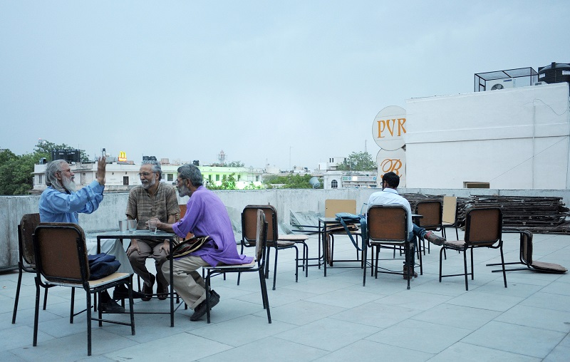 In this photograph taken on June 9, 2009, patrons relax in the open seating area of The Indian Coffee house in New Delhi. At first glance, the Indian Coffee House in New Delhi looks more like a run down school cafeteria than a venerable gathering spot of the city's intelligentsia. Everything about the cafe, from the shabby, outdated furniture to the rickety ceiling fans and mostly grey-haired male customers, suggests visitors have stepped into a time warp.These days though, there is more than just tea and coffee brewing at the legendary shop where prime ministers, freedom fighters and writers would rack their brains for hours. AFP PHOTO/Manpreet ROMANA (Photo credit should read MANPREET ROMANA/AFP/Getty Images)