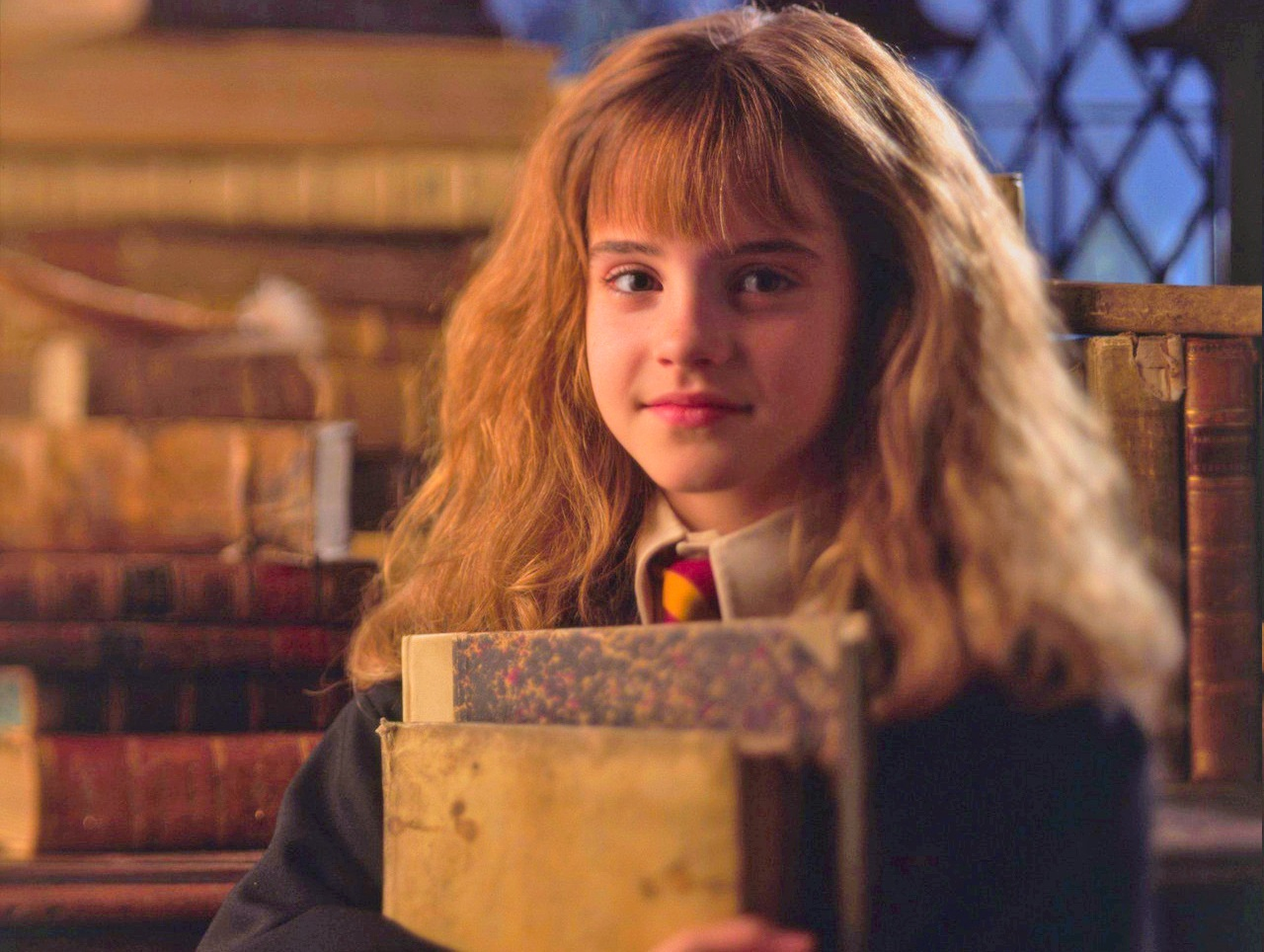 Hermione Granger with books