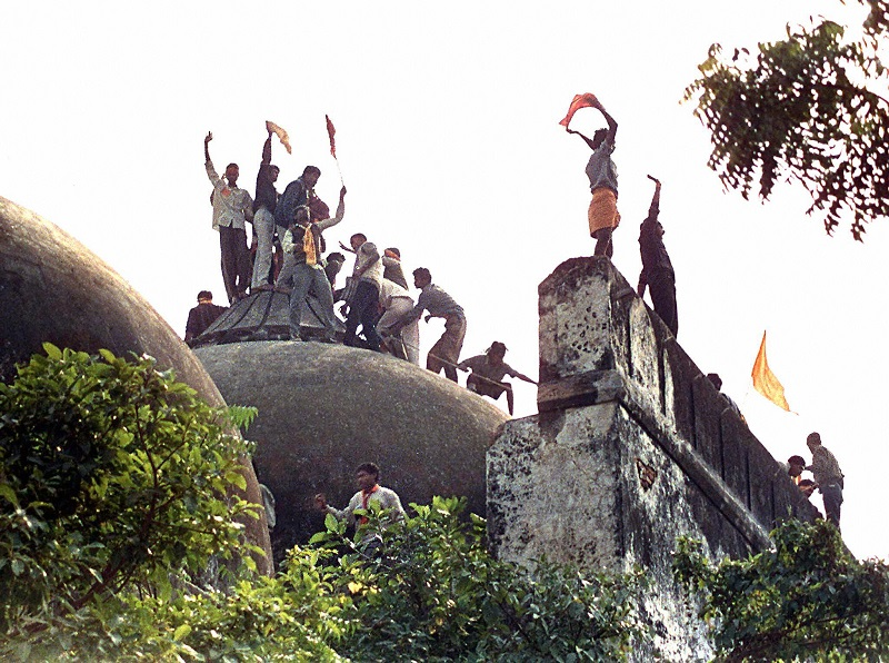 AYODHYA, INDIA - DECEMBER 6: Hindu youths clamour atop the 16th century Muslim Babri Mosque in this 06 December 1992 photo five hours before the structure was completely demolished by hundreds supporting Hindu fundamentalist activists. In 1947 India and Pakistan were ripped savagely apart. In 1997 there are a growing number of people who would like them stitched back together again. The trauma of partition persists and fears seemed to be underlined by the evocative image of Ayodhya, when the mosque was torn down amid claims that it had been built on the site of a former Hindu temple built where Lord Rama was born. (Photo credit should read DOUGLAS E. CURRAN/AFP/Getty Images)