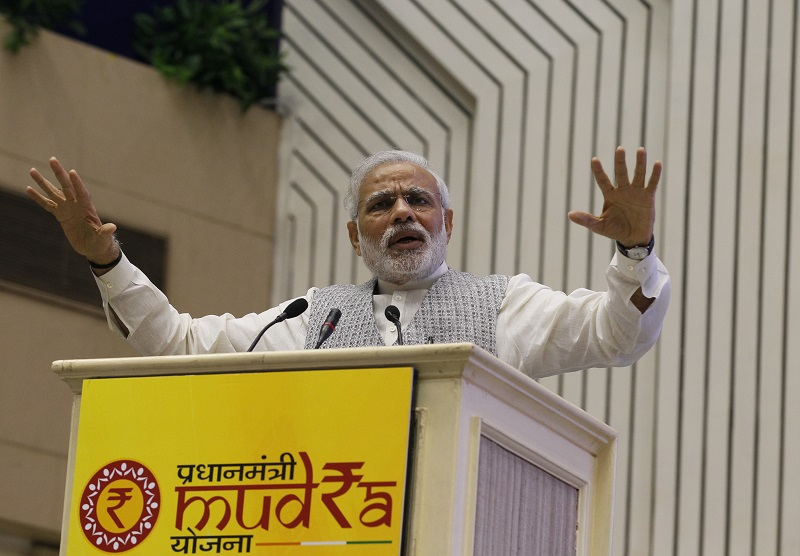 NEW DELHI, INDIA - APRIL 8: Prime Minister Narendra Modi address the gathering during the launch of the Pradhan Mantri MUDRA (Micro Units Development and Refinance Agency) Yojana at Vigyan Bhawan on April 8, 2015 in New Delhi, India. In his Budget Speech for Financial Year 2015-16, Union Finance Minister Arun Jaitley had proposed the creation of the bank, with a corpus of Rs. 20,000 crore, and credit guarantee corpus of Rs. 3,000 crore. The bank will extend credit of up to Rs.10 lakh to small businesses and regulate micro-finance institutions, to promote their growth, add to the country's output and create jobs. (Photo by Arvind Yadav/Hindustan Times via Getty Images)