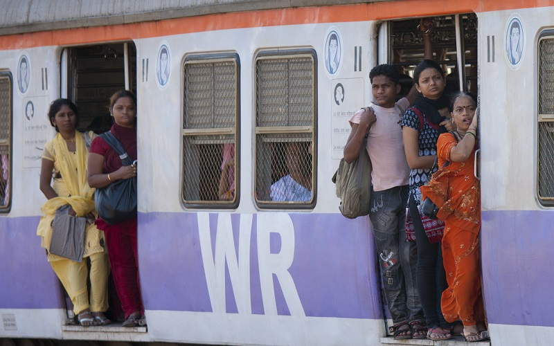 INDIA - MARCH 21: Female workers on crowded commuter train of Western Railway near Mahalaxmi Station on the Mumbai Suburban Railway, India (Photo by Tim Graham/Getty Images)