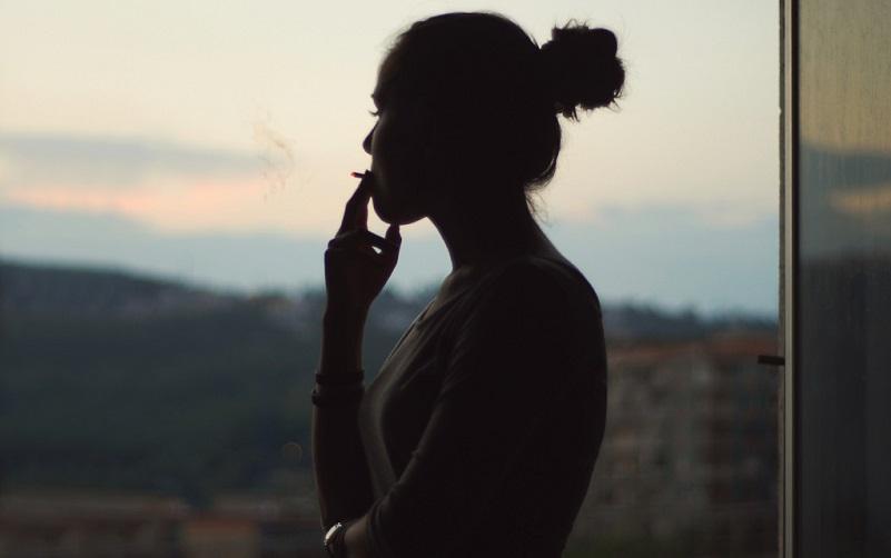 Silhouette of a girl smoking.