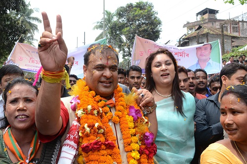 Indian candidate Himanta Biswa Sarma (2nd L) of the BJP is accompanied by supporters on the way to file nomination papers from Jalukbari Assembly Constituency in Guwahati on March 21 2016. Thousands of Indian voters will elect legislators for the 126 seats contested in 25,000 polling stations in Assam state in two phases on April 4th and 11th. / AFP / Biju BORO (Photo credit should read BIJU BORO/AFP/Getty Images)