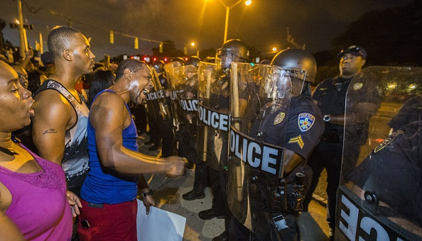 protesters face off with Baton Rouge police in riot gear