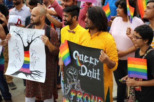 People with placards at the pride march