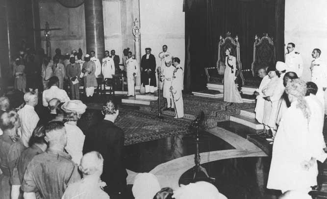 Lord Mountbatten swears in Pandit Jawaharlal Nehru as the first Prime Minister of free India at the ceremony held at 8.30 a. m.on August 15, 1947.