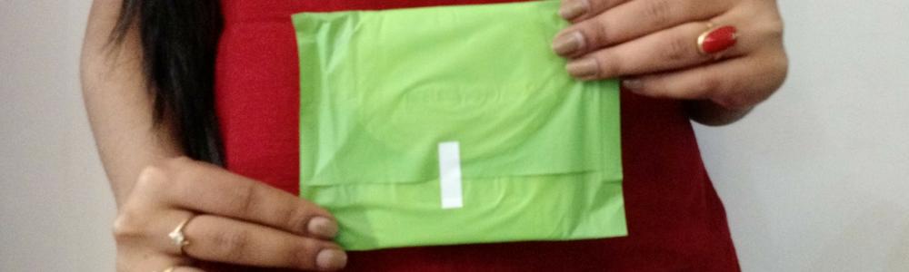 girl holding sanitary napkin banner