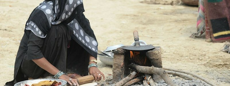 A woman cooks food outside a relief camp at Malakpur village in Shamli district. Photo credit: Sajjad Hussain/AFP/Getty Images