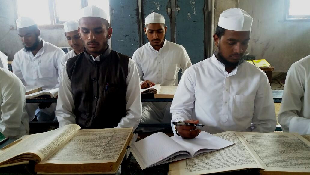 A group of students studying at a Madrasa