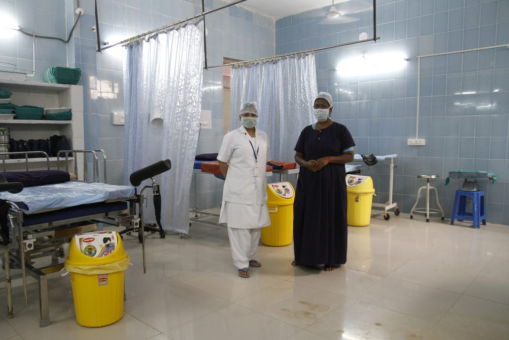 Fatima and Padma. Fatima in white. Labor room.Area Hospital, Banswada.District: Nizamabad