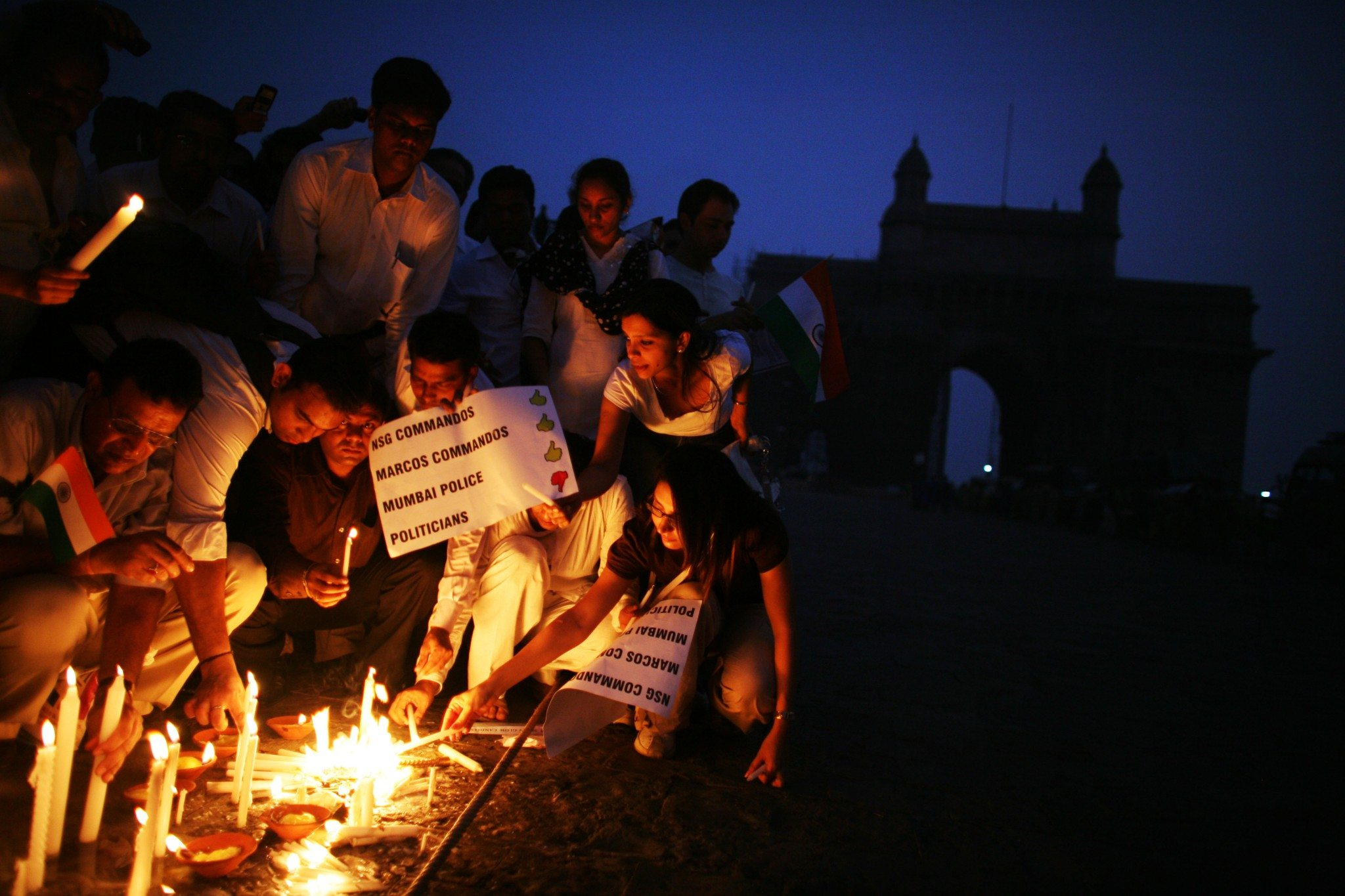 MUMBAI (BOMBAY), INDIA - DECEMBER 03: (ISRAEL OUT) Mumbaikars light candles as they take part in a mass demonstration march following last weeks series of terrorist attacks on the city, near the Taj Mahal Palace & Tower Hotel, on December, 03, 2008 in Mumbai, India. Two bombs were discovered and defused earlier today by Mumbai police at a train station, the Chhatrapati Shivaji Terminus, that was one of the locations attacked by the terrorists. The attacks left almost 200 hundred dead and injured over 300 people. (Photo by Uriel Sinai/Getty Images)